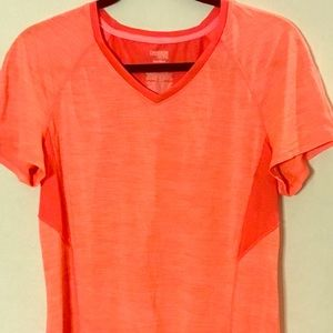 Danskin NOW semi-fitted orange work-out shirt.